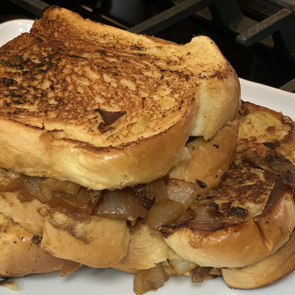 This decadent caramelized onion and hummus sandwich isn't pretty, but it has a very unique flavor that you're sure to fall in love with. | For Animals For Earth