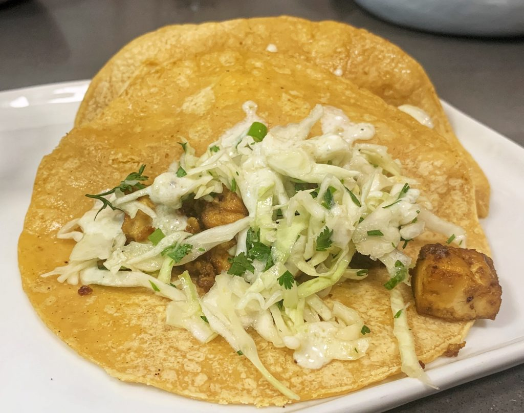 These tofu tacos with cilantro lime slaw are vegan and gluten free without losing any incredible flavor. They're a light and healthy meal. From the For Animals. For Earth. recipe blog.
